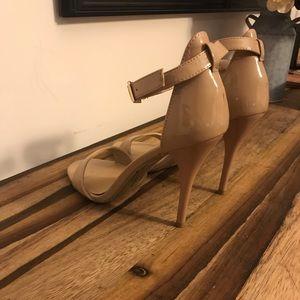 Stiletto heel sandals.